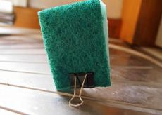 Use a binder clip to keep your sponge dry