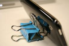 use two binder clips as a phone stand