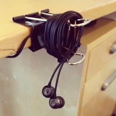 Use a binder clip to keep headphones tidy when not in use