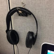 Use a binder clip pinned to the wall to keep your headphones in easy reach.